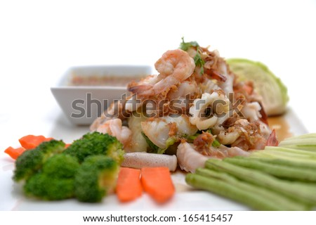 fried king prawns and squid with garlic and herbs