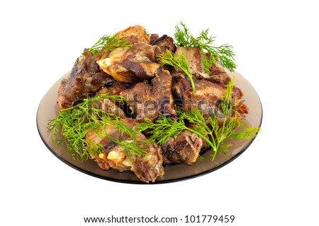 Fried meat on stones on a white background