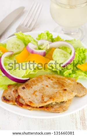 fried meat with fresh salad