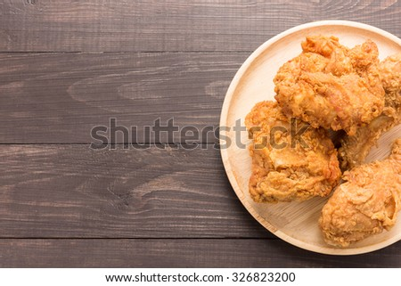 Fried mixed chicken on a wooden background. #326823200