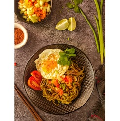 fried noodle from spring onion composition and mocaf flour which low gluten served with pickled contain of cucumber, carrots and raw chilles