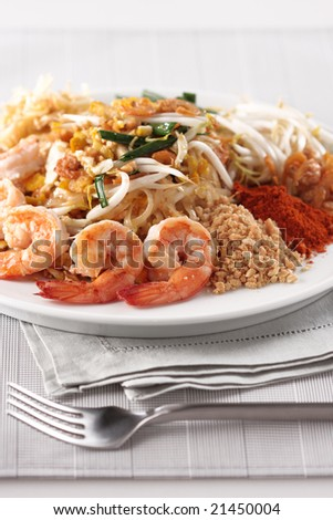 fried noodle, padthai, Thai famous dish, with shrimp, grounded peanut, chili and vegetable.