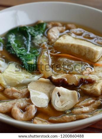 Fried noodles with kale, tofu, mushroom in gravy sauce in vegetarian festival. vegetarian food. #1200860488