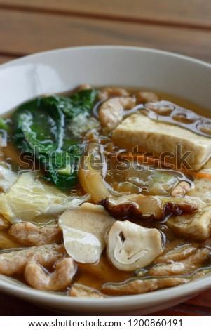 Fried noodles with kale, tofu, mushroom in gravy sauce in vegetarian festival. vegetarian food. #1200860491