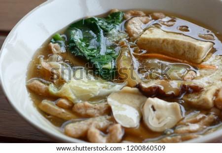 Fried noodles with kale, tofu, mushroom in gravy sauce in vegetarian festival. vegetarian food. #1200860509