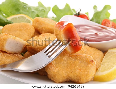 fried nuggets with ketchup