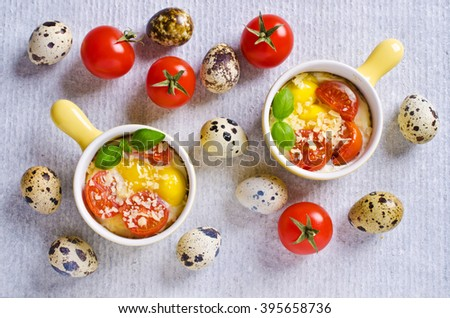 Fried of quail eggs with tomatoes and cheese in a batch manner. Selektivgy focus. #395658736