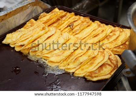 Fried omelettes for airline food portions on metal tray