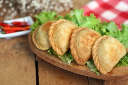 fried pastels atau pastel goreng  are a kind of pastry made by placing the stuffing on top of the dough, then folded and tightly closed. Pastels can taste sweet or savory
