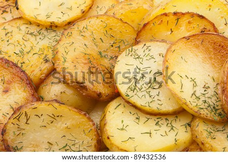 Fried pieces of potatoes with oil and dill.
