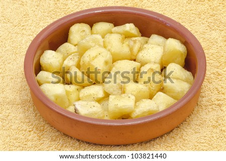 Fried pieces of potatoes with oil , dill pepper and salt. plate with typical spanish patatas bravas. - stock photo