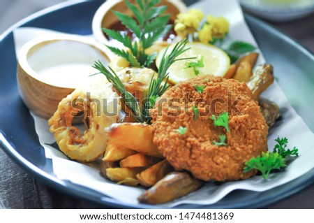 fried pork, deep fried pork or fried pork ball with onion ring and french fries