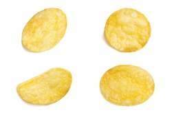 Fried potato chips snack isolated on white background. Delicious pieces of crispy golden chips. Tasty potato slices in close up. Natural organic product.