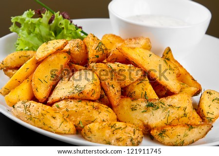 Fried potato wedges with white sauce and lettuce Stock photo ©