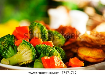 Fried potatoes broccoli carrots and roasted chicken