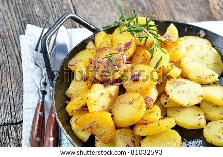 Fried potatoes in an iron pan