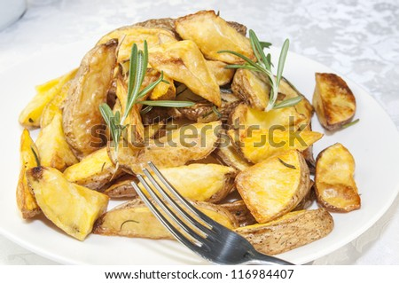 fried potatoes on a plate in a restaurant
