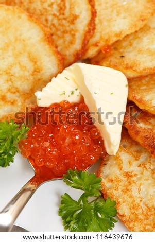 fried potatoes pancakes with caviar