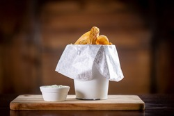 Fried potatoes snacks in a wooden background