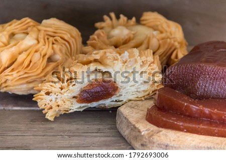 fried puff pastry cakes, filled with sweet potato and quince paste. Traditional Argentine dessert Photo stock ©