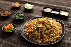 fried rice in plate on table in restaurant