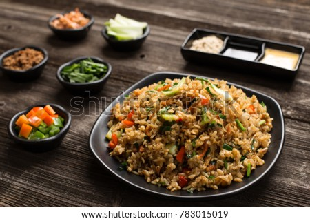fried rice in plate on table in restaurant #783015019