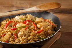 Fried rice nasi goreng with chicken and vegetables on a pan