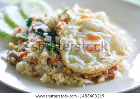 fried rice or stir-fried rice with fried egg and cucumber