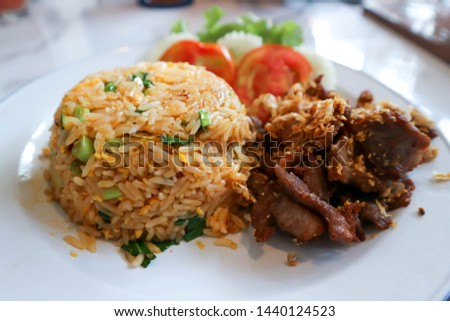 fried rice or stir-fried rice with fried egg and fried pork