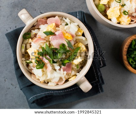 Fried rice with bacon and egg. Asian rice dish. Copy space.