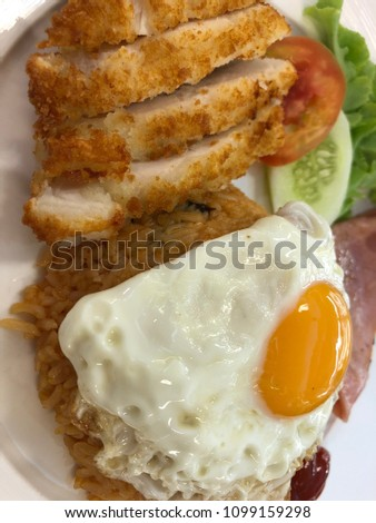 Fried rice with fried chicken and fried egg #1099159298