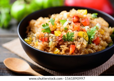 Fried rice with vegetables in a bowl, Asian food