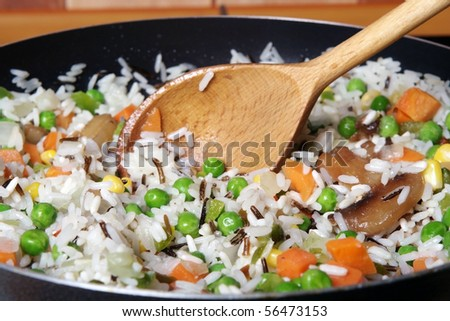 fried rice with vegetables in a skillet