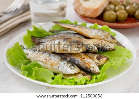 fried sardines on the plate