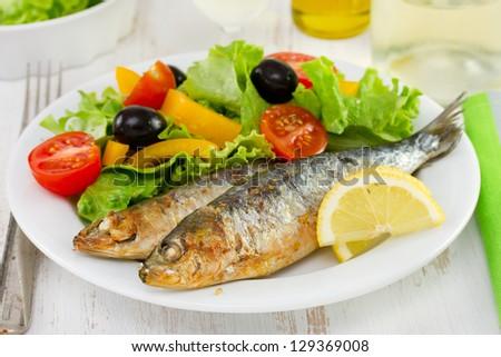 fried sardines with fresh salad