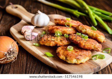 Shutterstock Fried savory tuna pancakes with potato, onion and garlic