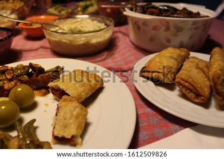 Fried savoury pastry with cheese and pastirma (Turkish pastrami) - (paçanga böreği).