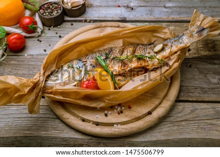 Fried sea bass on old wooden table Photo stock ©