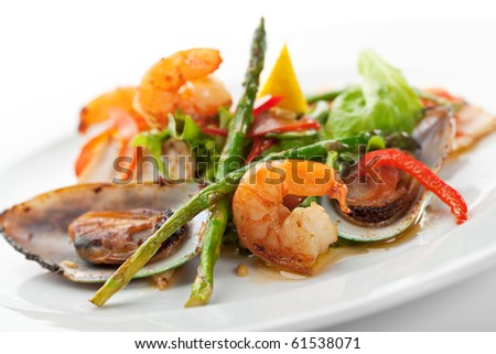 Fried Seafood Salad with Lemon Slice and Asparagus