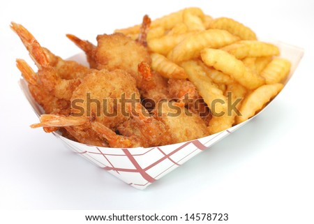 Fried shrimp and french fries basket isolated on white background.