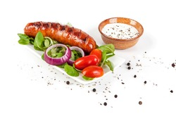 Fried Silesian sausage with salad isolated on white. View from another angle in the portfolio.