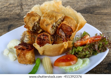 Fried spring rolls in eatable basket with salad leaves #451392376