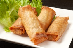 Fried spring rolls on a white plate