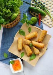 Fried spring rolls or egg rolls ( Por Pia Tord) with sweet chili sauce on the marble background- Top view