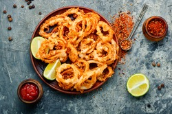 Fried squid or calamari rings with sauce.Fast food