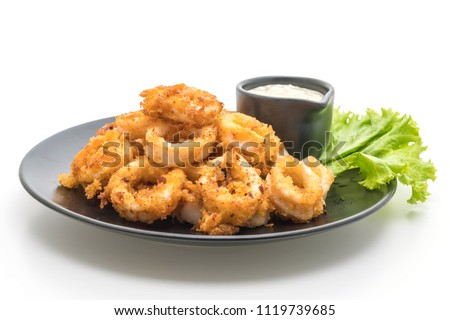 fried squids or octopus (calamari) with sauce isolated on white background