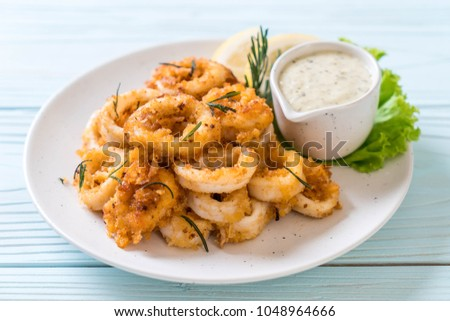 fried squids or octopus (calamari) with sauce - unhealthy foods Сток-фото ©