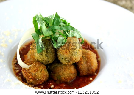 Fried Stuffed Olives - Green olives stuffed, breaded then fried to a golden brown with marinara.