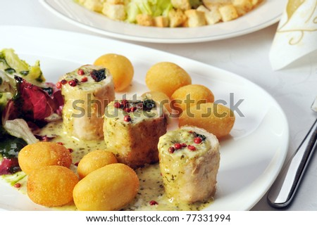 Fried stuffed turkey fillet with cheese and vegetables
