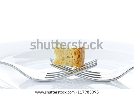 Fried toast with two forks on a white background